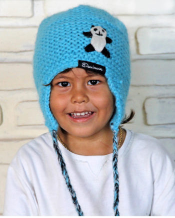 Boy wearing blue ANAK earflap beanie with panda
