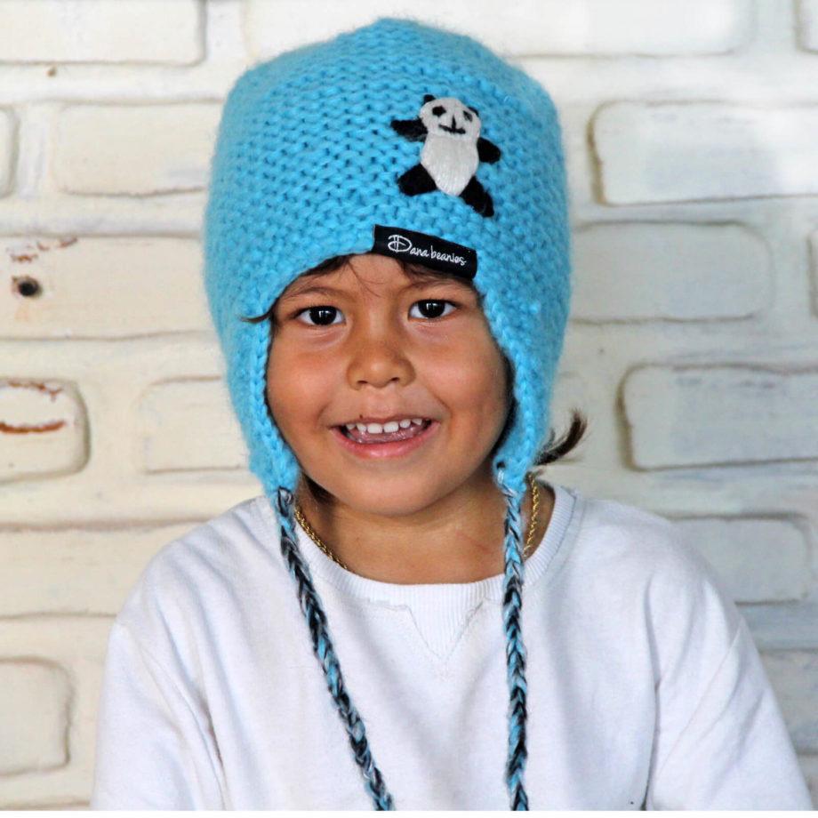 Boy wearing blue ANAK earflap beanie with panda