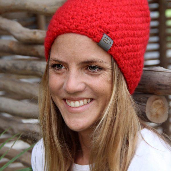 Woman wearing KARO red beanie