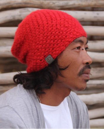 Man wearing KARO red beanie