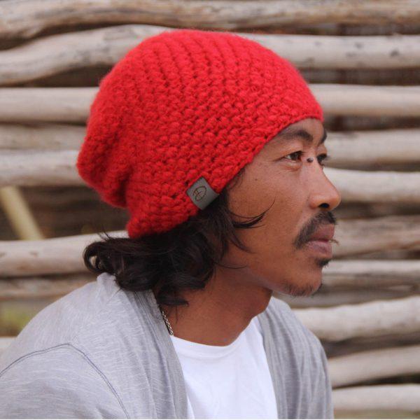Man wearing KARO red beanie
