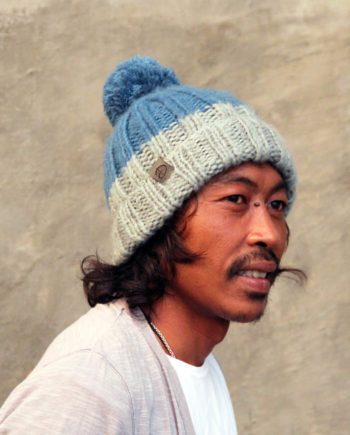 Man wearing LOTUS blue beanie