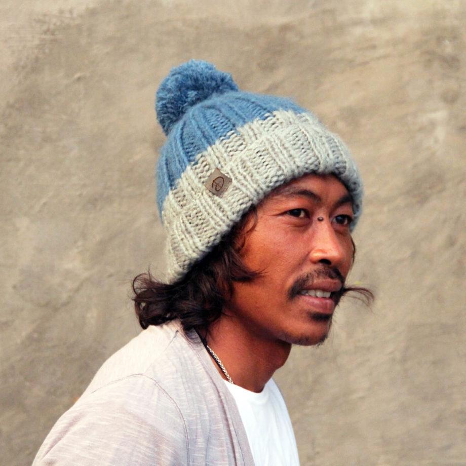 Man wearing LOTUS blue beanie