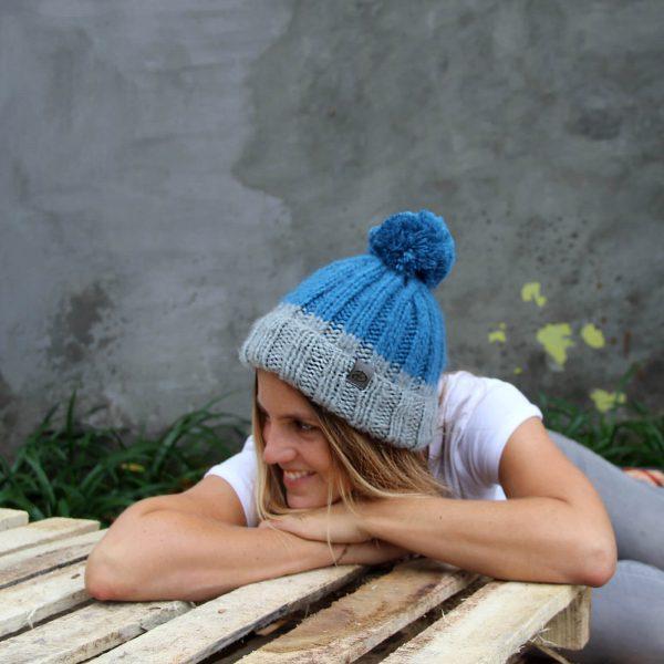 WOman wearing LOTUS blue beanie