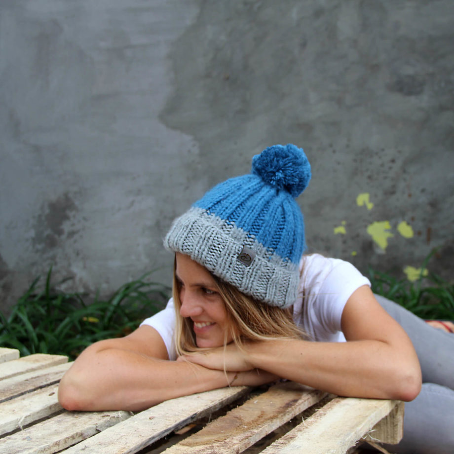 WOman wearing LOTUS blue beanie