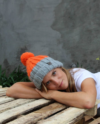 WOman wearing LOTUS orange beanie