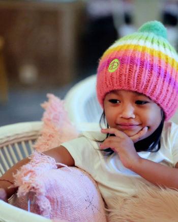 Girl wearing RAINBOW kids pink beanie