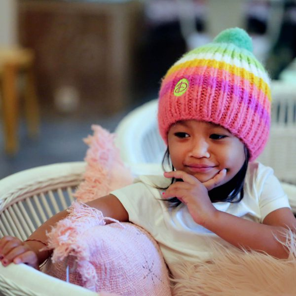 Girl wearing RAINBOW kids pink beanie