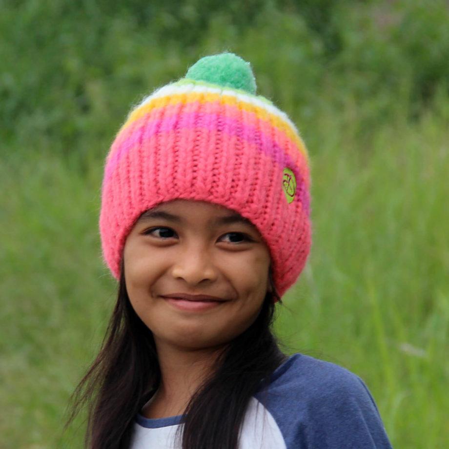 Girl wearing RAINBOW kids pink beanie 3