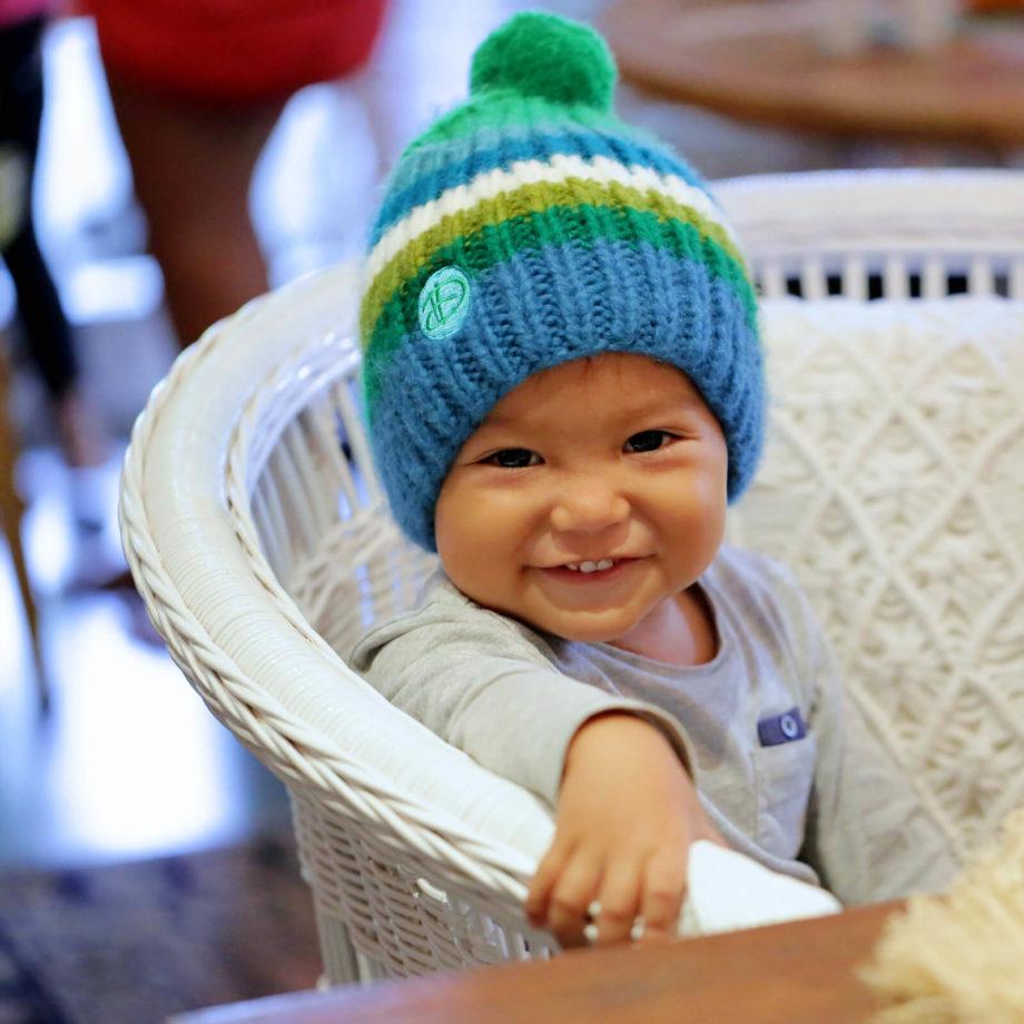 Baby wearing RAINBOW kids turkis beanie