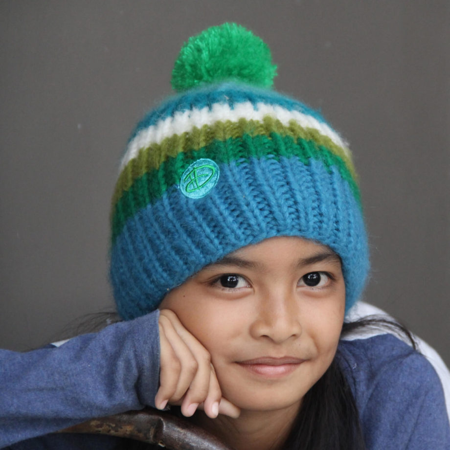 Girl wearing RAINBOW kids turkis beanie