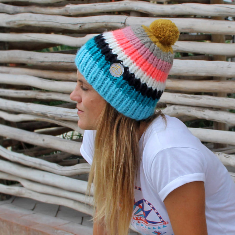Woman wearing RAINBOW adults coral beanie
