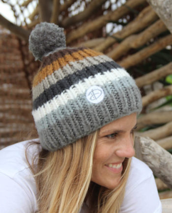 Woman wearing RAINBOW adults grey beanie