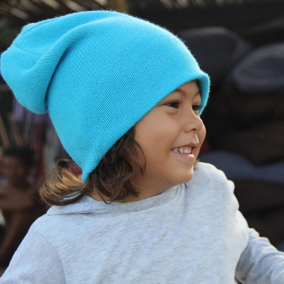 Boy wearing SRIKANDI kids ocean beanie