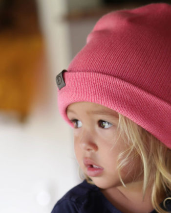 Girl wearing SRIKANDI kids rose beanie