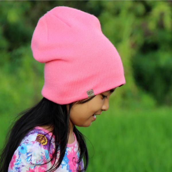 Girl wearing SRIKANDI kids rose beanie 2