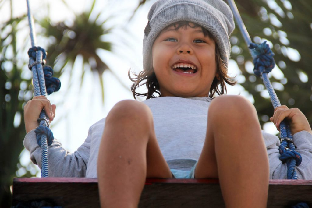 Happy kid on the swing